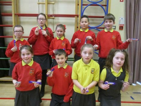 Winners of the KS2 Internet Safety Poster Competition pictured with their new memory sticks and a chocolate treat!